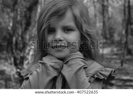 black and white portrait of a little girl in the woods