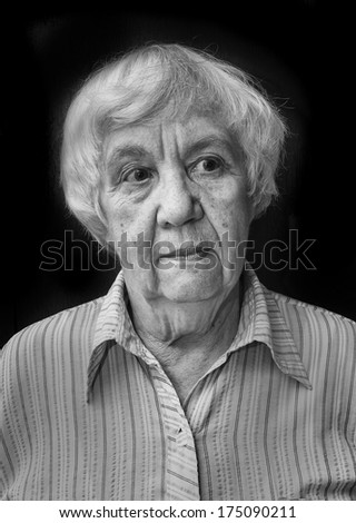 Black and white portrait of a lonely old woman  - stock photo
