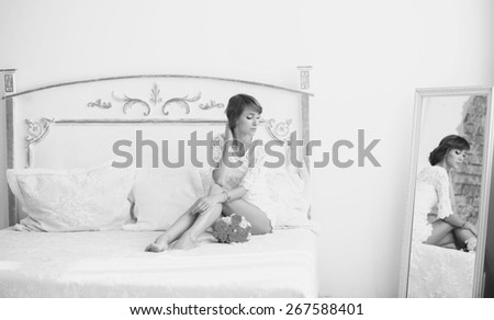 black and white portrait of a model with a mirror in the interior - stock photo