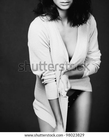 black and white portrait of a mysterious brunette - stock photo