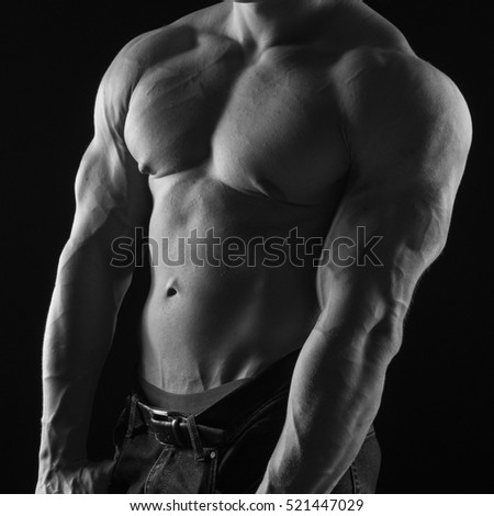 black-and-white portrait of a naked torso male bodybuilder athlete with long blond hair in studio
