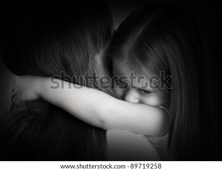 black and white portrait of a sad little girl and her mother - stock photo