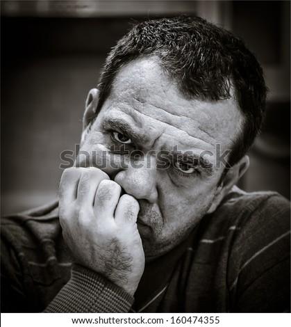Black and white portrait of a sad man. - stock photo