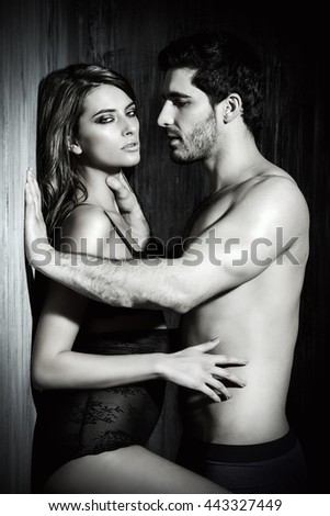 Black-and-white portrait of a sexy couple play in love games. BDSM. - stock photo