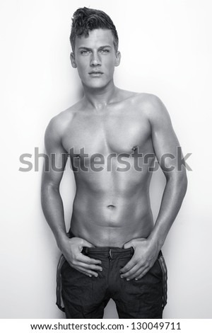 Black and white portrait of a sexy man - stock photo