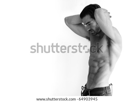 Black and white portrait of a sexy young shirtless man against white background with lots of copy space - stock photo