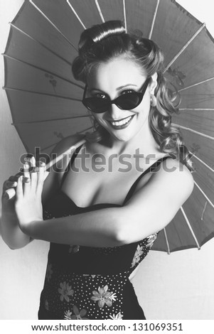 Black And White Portrait Of A Smiling Vintage Lady With Classical Hair, Makeup And Fashion Dancing With A Retro Umbrella - stock photo