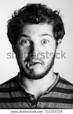 Black and White Portrait of a Young College Boy making a silly face - stock photo