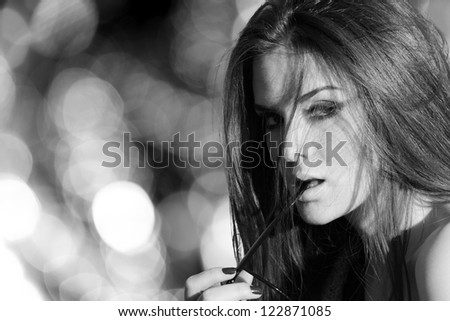Black and white portrait of a young woman - stock photo
