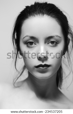 black and white portrait of a young woman with messy hair - stock photo
