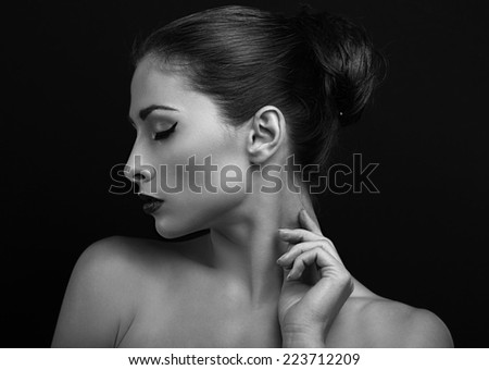 Black and white portrait of beautiful female model posing. Closeup - stock photo