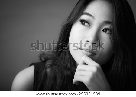 Black and white portrait of beautiful happy woman - stock photo