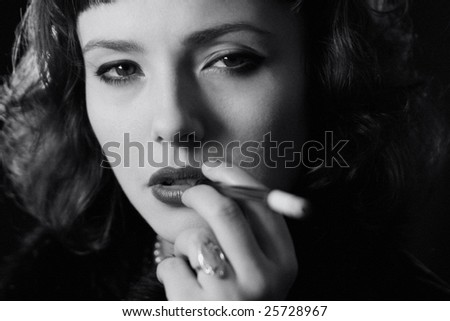 Black and white portrait of beautiful model, grain added. - stock photo