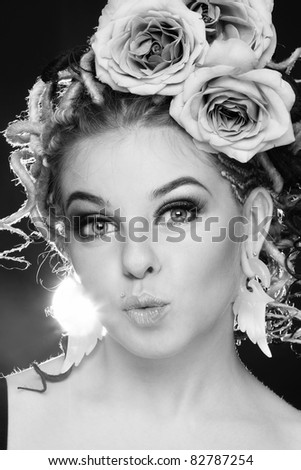 Black and white portrait of beautiful sexy girl with dreads and roses