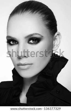 Black and white portrait of beautiful stylish young woman with smoky eyes - stock photo