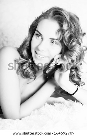 Black and white portrait of beautiful woman talking on phone - stock photo