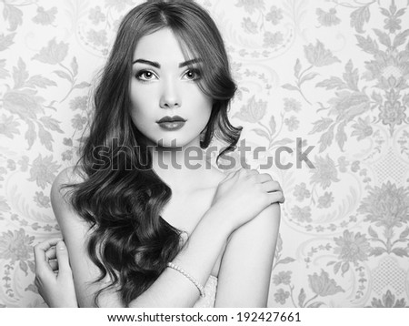 Black and white portrait of beautiful woman with nude make-up. Fashion photo.