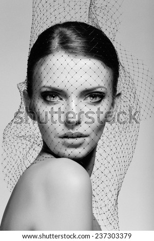 Black and White portrait of beauty. Amazing girl posing in black veil. - stock photo