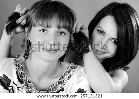 black and white portrait of beutiful young sisters - stock photo