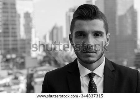 Black and white portrait of businessman outdoors