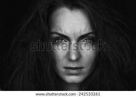 Black and white portrait of crying woman - stock photo
