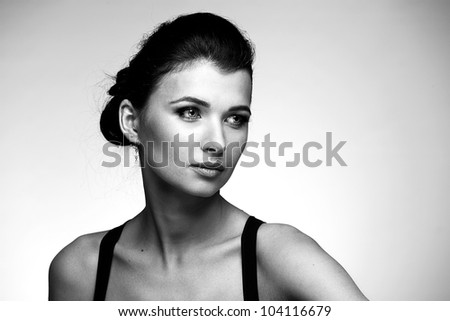 Black and white portrait of fashion woman in black dress on natural background - stock photo