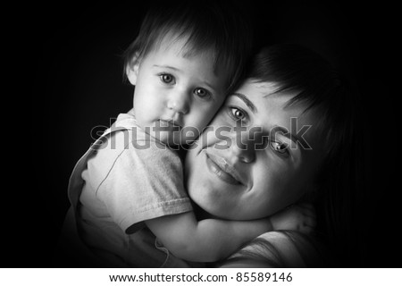 black and white portrait of happy mother and baby - stock photo