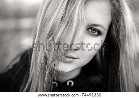 black and white portrait of long hair blond girl - stock photo