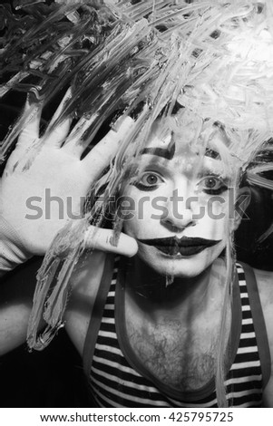 Black and white portrait of Mime behind the glass  - stock photo
