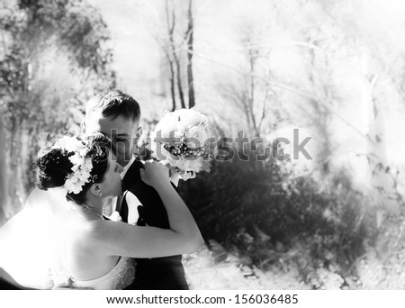 Black and white portrait of newly married couple - stock photo