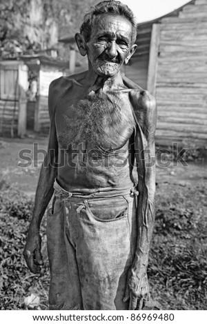 black and white portrait of poor farmer of tobacco plantation, cuba - stock photo