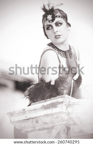 Black and White Portrait of The Beautiful Retro woman in Black Lace and Accessories in Style 1920s - 1930s  - stock photo