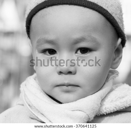 Black and white portrait of three year old boy