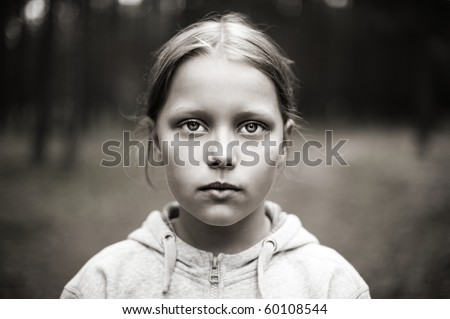 Black and white portrait of tired little girl with sad eyes. Shallow DOF - stock photo