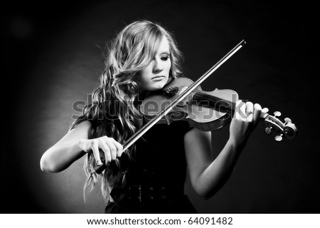 Black and white portrait of young, beautiful violinist playing her violin - stock photo
