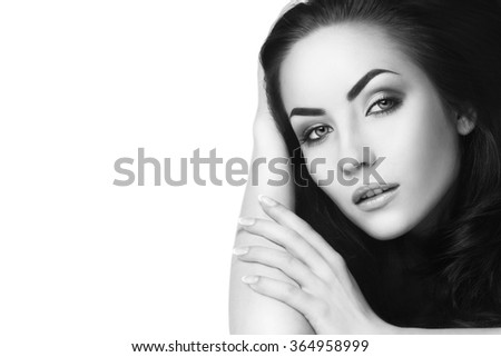 Black and white portrait of young beautiful woman with long dark hair, copy space