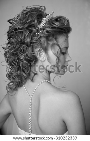 Black and white Portrait of young bride ,professional hairstyle and make-up - stock photo