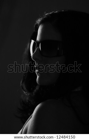 Black and white portrait of young woman wearing sunglasses