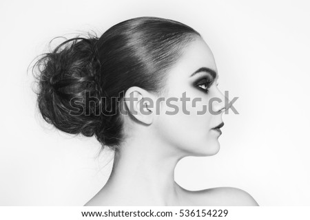 Black and white profile portrait of young beautiful woman