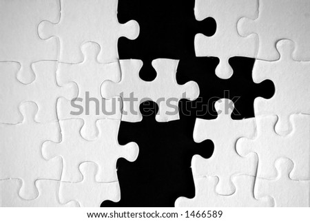 Black and white puzzle - stock photo