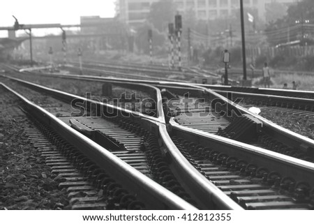 Black and white railway point (soft focus) - stock photo