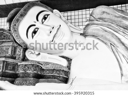 Black and white reclining Buddha is bethel second holy city of Bago, Myanmar. Buddhist place is Art Mon.  - stock photo