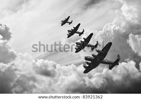 Black and white retro image of Lancaster bombers from Battle of Britain in World War Two - stock photo