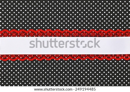 Black and white retro polka dot textile background with ribbon - stock photo