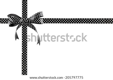 Black and white ribbon with a bow on a white background - stock photo