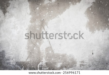 Black and white rough cement wall - stock photo