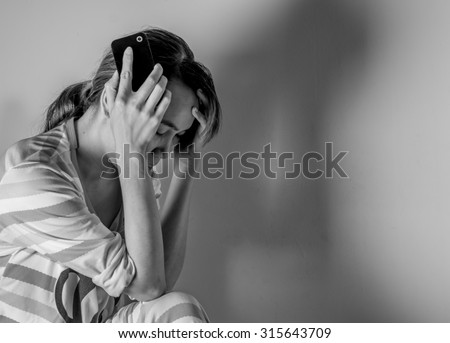 Black and White sad ,worried,or anxious woman falls and  hole mobile phone with space,asian women - stock photo