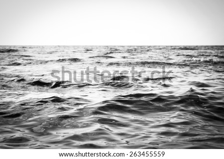 Black And White Seascape Of The Calm Kona, Hawaii Shoreline Waters Located On The Island Of Hawaii On A Bright, Sunny, And Tropical Beach Vacation Day - stock photo