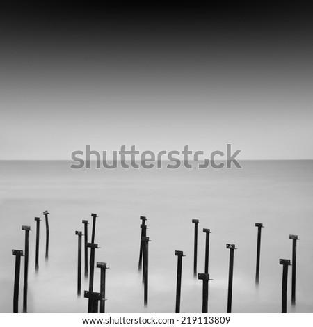 Black and white seascape with metal object in the sea, Black sea, Odessa, Ukraine - stock photo
