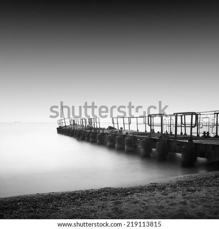 Black and white seascape with metal pier in the sea, Black sea, Odessa, Ukraine - stock photo